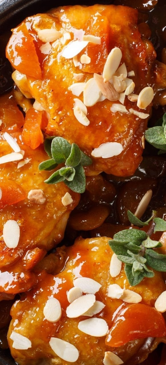 Slow cooker apricot chicken thighs recipe. Bone-in and skin-on chicken thighs with apricot preserves, Dijon mustard, soy sauce, and vegetables cooked in a slow cooker.#slowcooker #crockpot #chicken #dinner #thighs #food #recipes