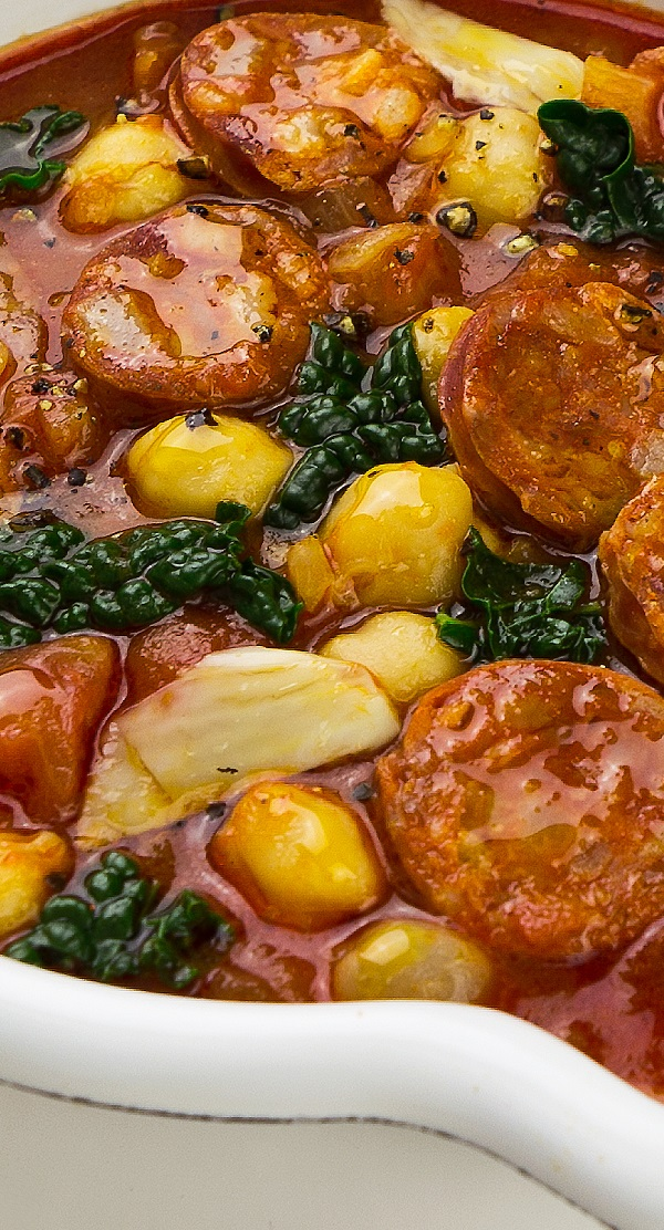 Slow cooker kale and chorizo soup. Delicious Portuguese with vegetables, chorizo sausages, and spices soup cooked in a slow cooker. #slowcooker #crockpot #soup #dinner #kale #chorizo #portugese