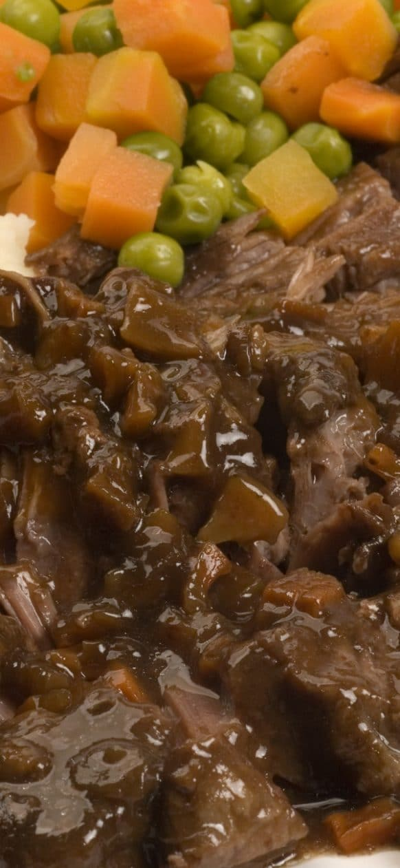 Slow cooker Yankee pot roast recipe. Beef pot roast with vegetables, beef broth, dry red wine, and mushrooms cooked in a slow cooker. #slowcooker #crockpot #dinner #potroast #yankee