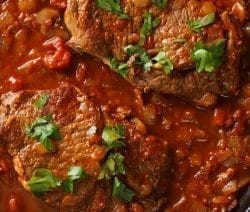 Pressure cooker Swiss steak casserole recipe. Beef round steak with vegetables, tomato paste and dry red wine cooked in electric pressure cooker. #instantpot #pressurecooker #beef #steak #dinner #casserole #homemade