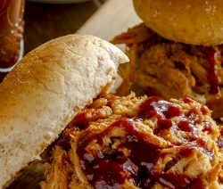 Slow cooker barbecued pork sliders. Pulled pork tenderloin with BBQ sauce cooked in a slow cooker and served on toasted buns. #slowcooker #crockpot #pork #dinner #sliders #bbq