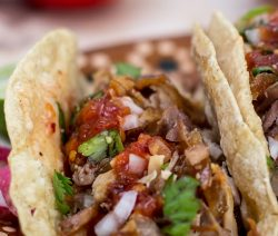 Slow cooker pork tacos. This delicious slow cooker recipe belongs to Caribbean cuisine. Pork with vegetables and spices cooked in slow cooker. #slowcooker #crockpot #pork #tacos #dinner #lunch #street #carnitas #mexican