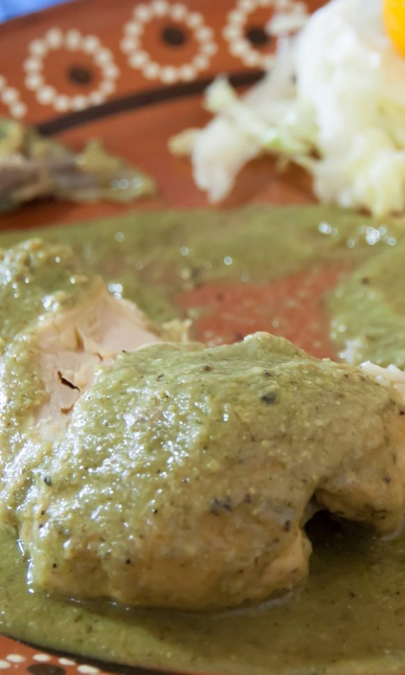 Slow cooker salsa verde chicken. Chicken thighs with vegetables, herbs, and delicious homemade salsa cooked in a slow cooker. #slowcooker #crockpot #chicken #dinner #mexican #salsa #verde #lunch
