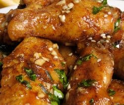 Slow cooker tamarind and orange-glazed chicken wings. Sweet and spicy chicken wings cooked in a slow cooker. Very delicious appetizer! #slowcooker #crockpot #chickenwings #chicken #dinner #appetizer #homemade #party