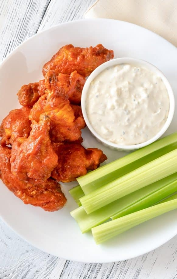 Slow cooker Buffalo wings with blue cheese dip. Spicy chicken wings cooked in a slow cooker and served with delicious homemade blue cheese dip. An excellent appetizer! #slowcooker #crockpot #appetizers #chicken #chickenwings #dinner #homemade