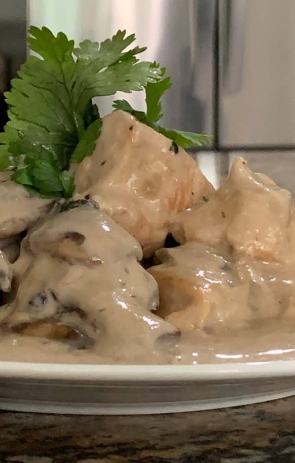 Slow cooker creamy chicken. Chicken breasts with cheese, sour cream, and vegetables cooked in slow cooker. Very easy and delicious! #slowcooker #crockpot #chicken #dinner #easy #creamy
