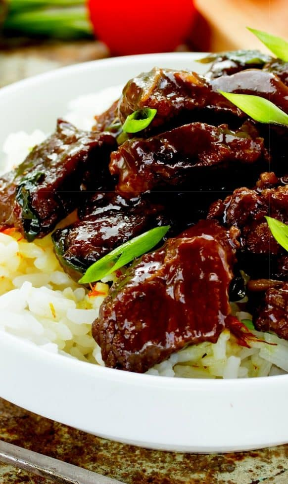 Slow cooker keto Mongolian beef recipe. Beef flank steak with spices cooked in slow cooker. Healthy and tasty beef recipe. #slowcooker #crockpot #dinner #keto #glutenfree #diet #healthy #homemade