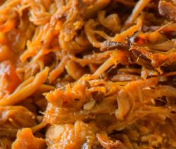 Slow cooker Oriental shredded pork. This is a very simple and easy recipe. Chunked pork shoulder with soy and hoisin sauces cooked in slow cooker and served in whole-wheat pita bread. #slowcooker #crockpot #dinner #pork #easy #shredded #spicy #magicskilletrecipes