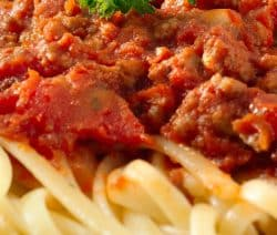 Slow cooker pasta Bolognese recipe. Very popular Italian recipe with ground beef, vegetables, and tomato sauce cooked in a slow cooker and served over the cooked spaghetti. #slowcooker #crockpot #dinner #pasta #delicious #easy