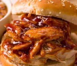 Slow cooker pulled chicken sandwiches. Learn how to cook delicious pulled BBQ chicken a slow cooker. One of my favorite chicken recipes! #slowcooker #crockpot #chicken #bbq #sandwiches #dinner #homemade