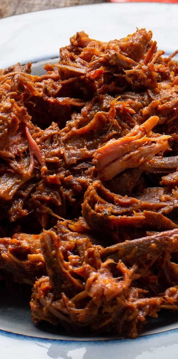 Slow cooker spicy barbacoa beef recipe. Beef chuck roast with vegetables and spices cooked in a slow cooker. This beef recipe belongs to Mexican cuisine and can be made in the oven or pressure cooker. #slowcooker #crockpot #beef #dinner #spicy #mexican