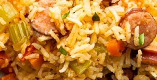 Pressure cooker Cajun rice and sausage recipe. Andouille sausages with rice, vegetables and Cajun spices cooked in an electric instant pot. #pressurecooker #instantpot #dinner #sausages #rice #cajun #homemade