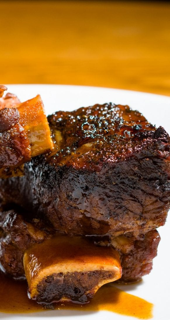 Slow cooker braised short ribs. Tasty and juicy beef short ribs with dry red wine cooked in a slow cooker. #slowcooker #crockpot #diner #ribs #braised
