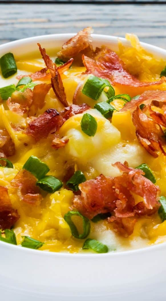 Slow cooker cheesy potato soup. Delicious potato soup cooked in a slow cooker. There's nothing fancy or surprising about this simple soup-it's tried and true. #slowcooker #crockpot #soup #potatp #cheesey #bacon #dinner #homemade