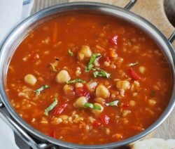 Slow cooker garbanzo and couscous soup. This delicious vegetarian soup belongs to Moroccan cuisine. The addition of couscous enhances this flavorful soup. Very easy to make. #slowcooker #crockpot #vegetarian #healthy #vegan #dinner #magicskilletrecipes