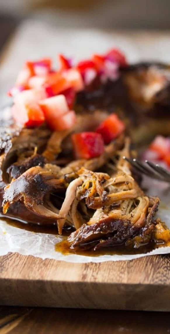 Crock pot balsamic pork tenderloin recipe. Balsamic glazed pork loin cooked in a slow cooker and served with delicious homemade strawberry salsa. #slowcooker #crockpot #pork #dinner #homemade #salsa