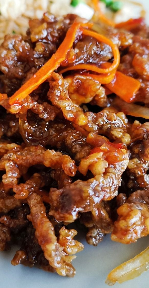 Crock pot honey-garlic shredded beef recipe. Beef roast with vegetables, Worcestershire sauce, soy sauce, and beef stock cooked in a slow cooker. #slowcooker #crockpot #dinner #beef #homemade #shredded