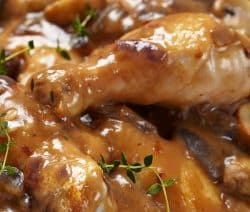 Slow cooker chicken and mushrooms in wine sauce. Chicken with mushrooms, vegetables, and dry red wine cooked in a slow cooker. Very easy and delicious! #slowcooker #crockpot #chicken #dinner #mushrooms #homemade