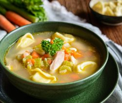 Easy slow cooker chicken tortellini soup recipe. Chicken broth-based soup with vegetables and chicken cooked in a slow cooker and served with cooked cheese tortellini. #slowcooker #crockpot #dinner #chicken #soup #magicskilletrecipes #tortellini