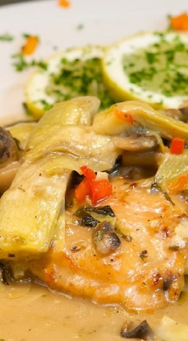 Slow cooker chicken with artichokes. Chicken breasts with vegetables and mushrooms cooked in a slow cooker. #slowcooker #crockpot #chicken #dinner #mushrooms #artichokes #homemade