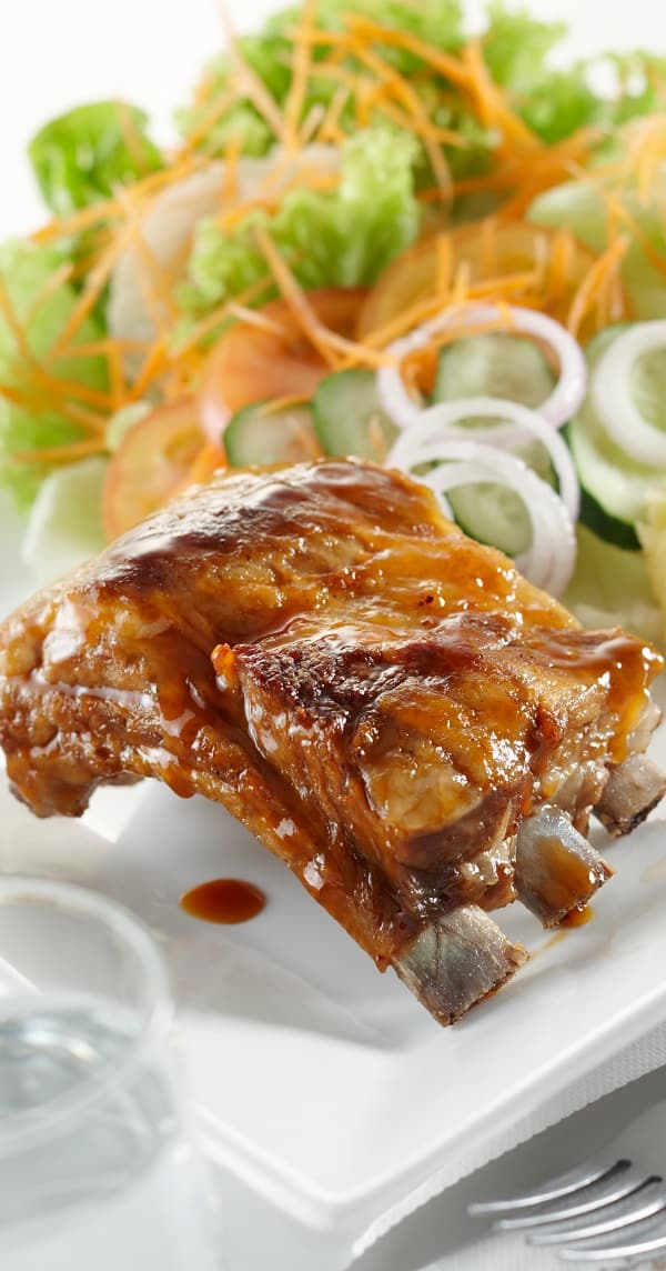 Slow cooker country-style ribs with plum sauce. Pork ribs with honey, soy, and plum sauces cooked in a slow cooker. Plum sauce and honey make these pork ribs sweet eating. #slowcooker #crockpot #ribs #dinner #homemade #easy