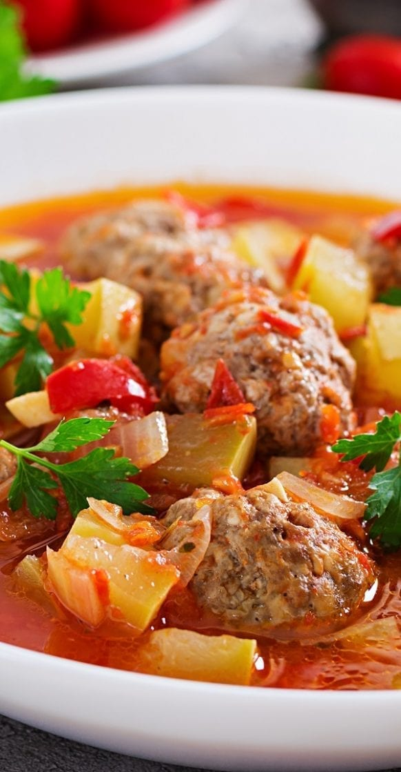 Slow cooker Mexican meatball soup. Meatballs with vegetables cooked in a slow cooker. A great favorite in Mexico, this delicious soup is traditionally seasoned with fresh mint. #slowcooker #crockpot #mexican #meatballs #soup #dinner #homemade
