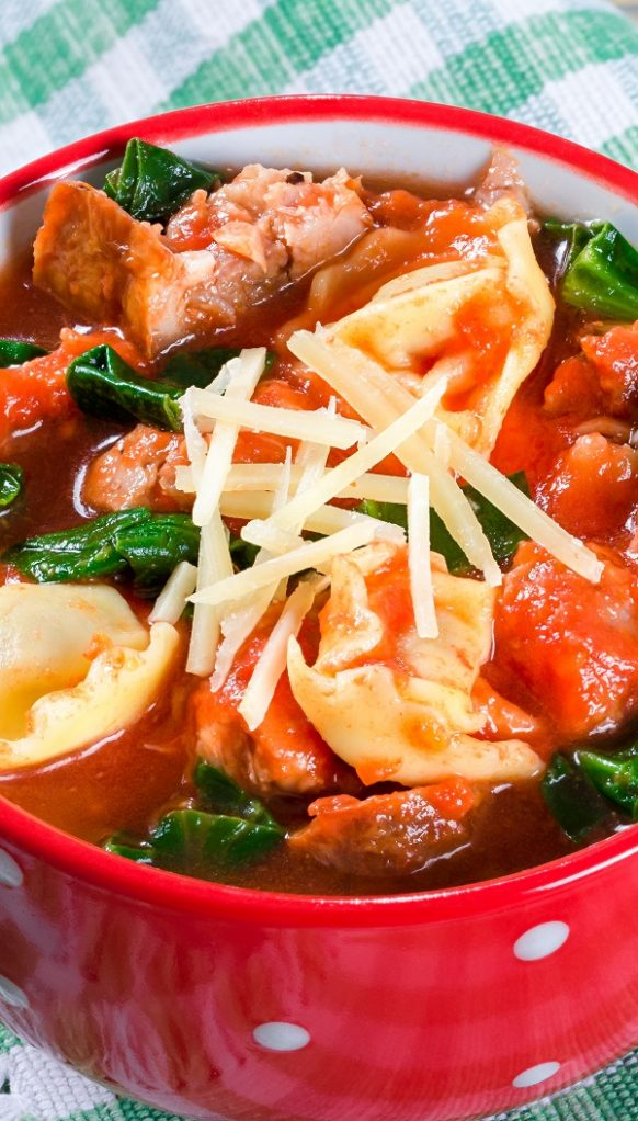Slow cooker tortellini-sausage soup. Easy and delicious Italian soup cooked in a slow cooker. #slowcooker #crockpot #dinner #soup #sausages #recipes #food #cooking