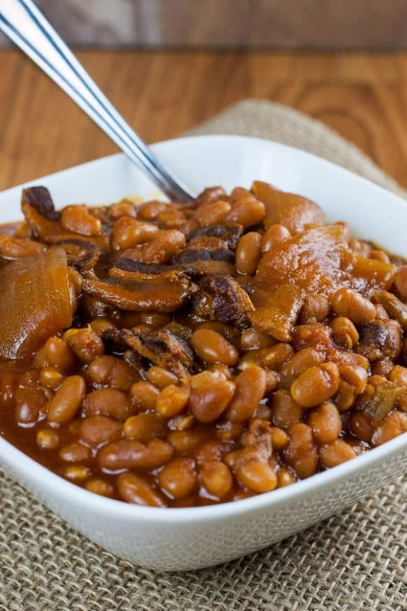 Slow cooker baked beans. Beans with homemade maple syrup, bacon, and vegetables cooked in a slow cooker. New England style! #slowcooker #crockpot #dinner #beans #homemade