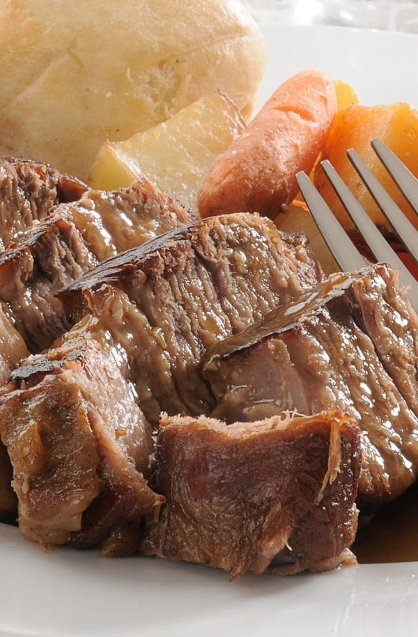 Slow cooker coffee pot roast. Beef rump roast with soy sauce, coffee, and vegetables cooked in a slow cooker. Great beef recipe! #slowcooker #crockpot #beef #recipe #dinner #potroast #coffee #homemade
