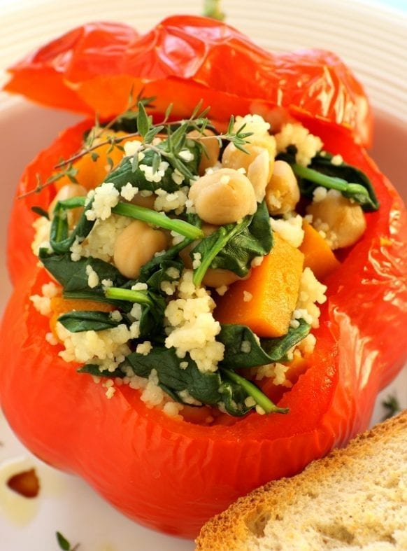 Slow cooker vegetable-stuffed peppers. Vegetable-stuffed bell peppers cooked in a slow cooker. Easy and healthy vegetarian recipe. #slowcooker #crockpot #vegetarian #vegan #stuffed #dinner #healthy