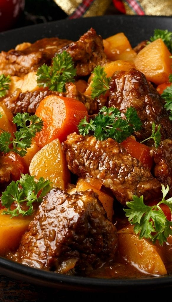 Slow cooker wine-braised beef stew. Cubed beef with vegetables and dry red wine cooked in slow cooker. The slow cooking gives this delicious dish a rich flavor. #slowcooker #crockpot #stew #beef #braised #dinner #easy #homemade