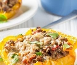 Crock pot stuffed bell peppers recipe. Bell peppers stuffed with cooked rice, meat, cheese cooked in a crock pot/slow cooker. #slowcooker #crockpot #stuffed #peppers #dinner #easy #yummy #homemade