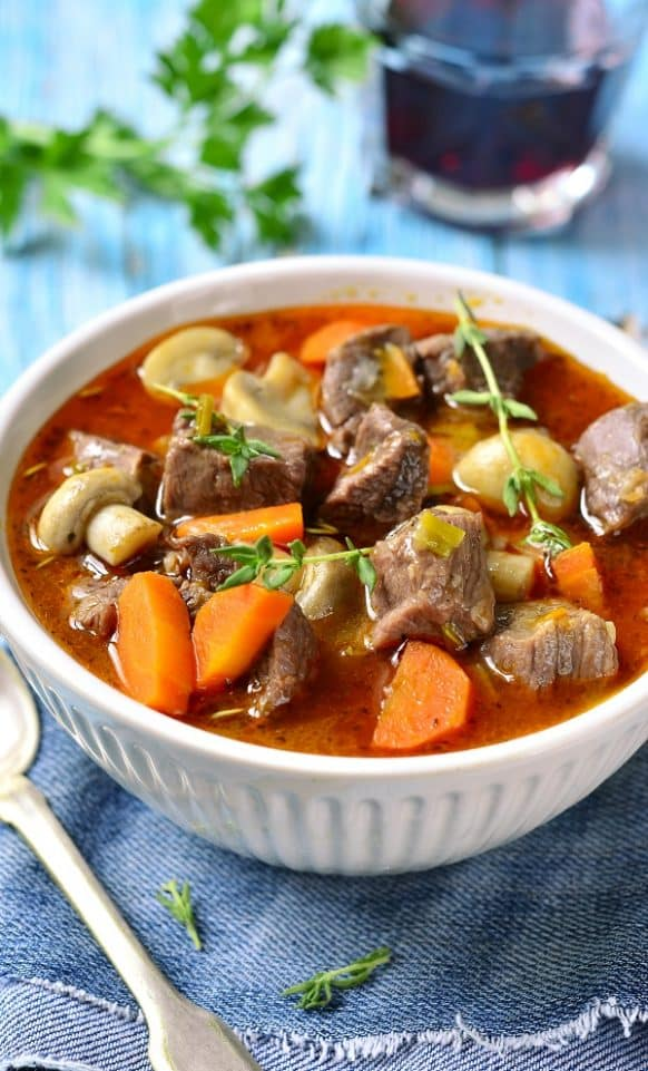 Slow cooker beef stew provencal. Delicious beef stew with dry red wine, mushrooms, and vegetables cooked in a slow cooker. This recipe belongs to Fine French Cuisine. #slowcooker #crockpot #beef #stew #dinner #homemade