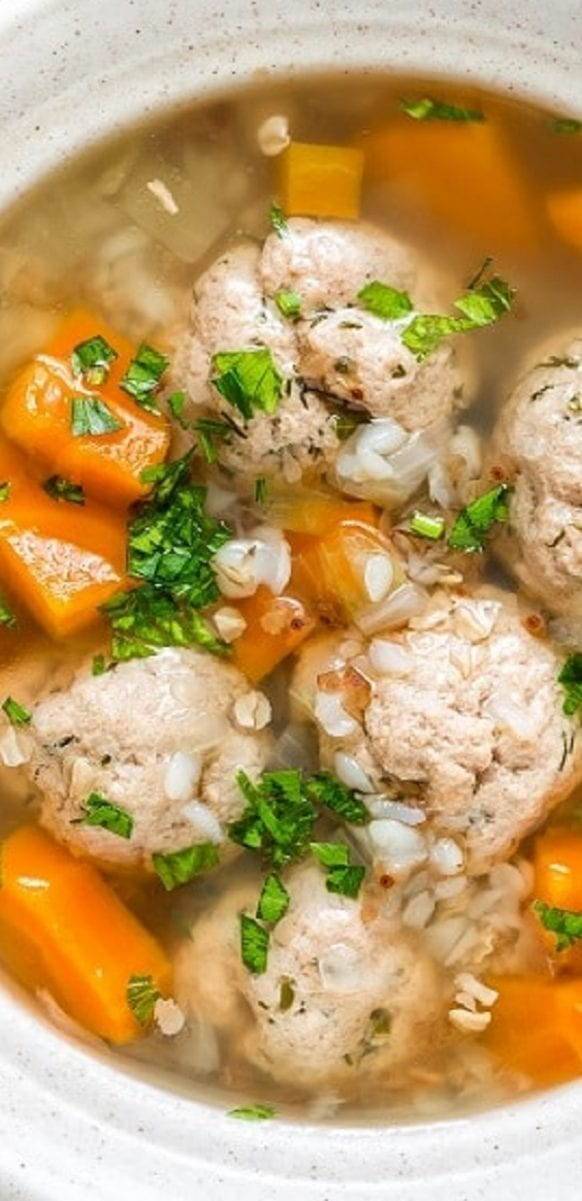 Slow cooker chicken meatball soup. Delicious vegetable soup with chicken meatballs cooked in a slow cooker. #slowcooker #crockpot #chicken #dinner #soup #meatballs