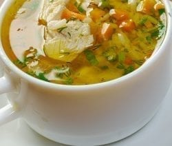 Slow cooker chunky chicken soup. Cubed chicken breasts with vegetables and rice cooked in a slow cooker. #slowcooker #crockpot #chicken #soup #dinner #homemade