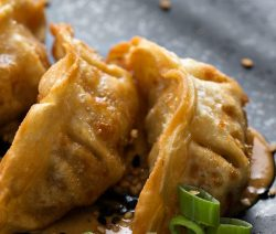 Air fryer cabbage and pork gyoza recipe. Cook delicious meat and vegetable-stuffed gyozas in an air fryer. #airfryer #dinner #lunch #recipes #food #cooking