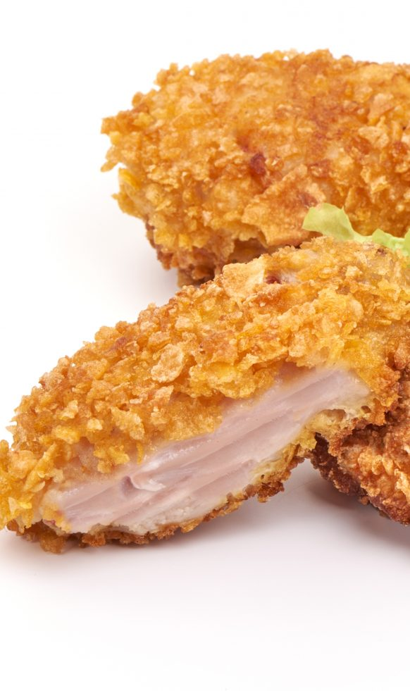 Air fryer potato flake-crusted chicken recipe. Learn how to cook crusted chicken breasts in an air fryer. #airfryer #dinner #appetizers #chicken #recipes #crusted