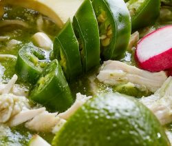 Slow cooker Mexican chicken pozole soup recipe. Super easy and delicious Mexican soup cooked in a slow cooker. #slowcooker #crockpot #mexican #summerrecipes #pozole #soup #dinner