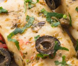 Instant pot baked cod recipe. Cod fillets with olives, capers, and spices cooked in an e;electric instant pot and served with tomatoes. Super easy and delicious Italian recipe. #pressurecooker #instantpot #dinner #fish #cod #seafood #italian