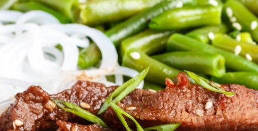 Air fryer Mongolian beef recipe. Beef flank steak with soy sauce and garlic cooked in an air fryer and served over the cooked rice and green beans. #airfryer #dinner #beef #steak #mongolian #delicious